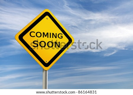 COMING SOON road sign against  blue sky - stock photo