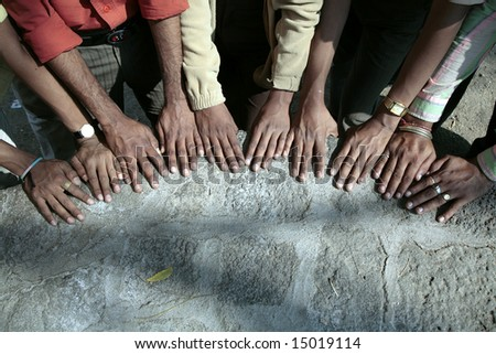 command work - a lot of male hands alongside - stock photo