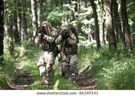 commando in forest - stock photo