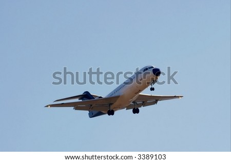Commercial aircraft against blue sky - stock photo