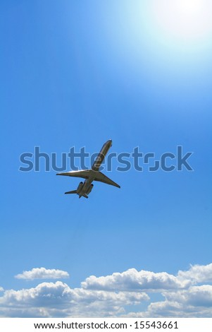 Commercial aircraft breaking through the clouds - stock photo