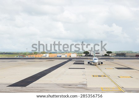 Commercial airplane on parking strip at airport. Scenic cloudy sky. Front view. - stock photo