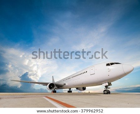 Commercial airplane parking - stock photo