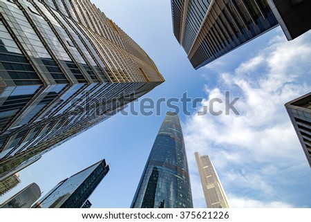 Commercial building in the blue sky white cloud background - stock photo