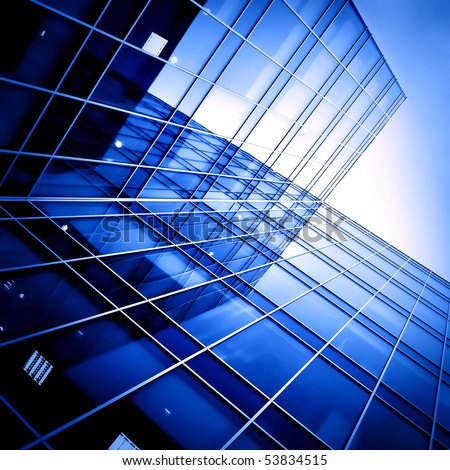 commercial glass building in haze - stock photo