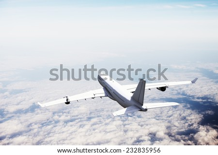 Commercial plane flying above the clouds. - stock photo
