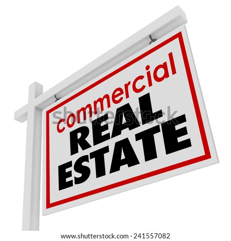 Commercial Real Estate sign to advertise or illustrate the sale of an office building or retail store for a business to move to a new location - stock photo