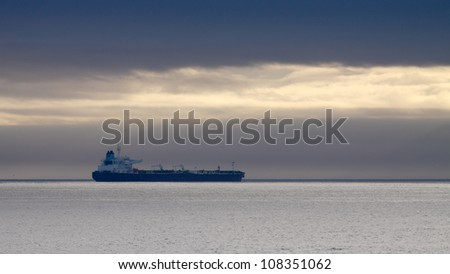 Commercial ship anchored off the coast