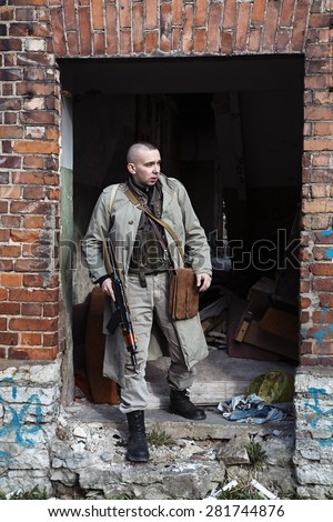 Comming out of the old brick ruins - stock photo