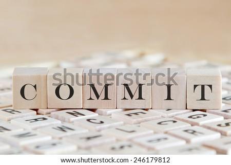 commit word on wood blocks - stock photo