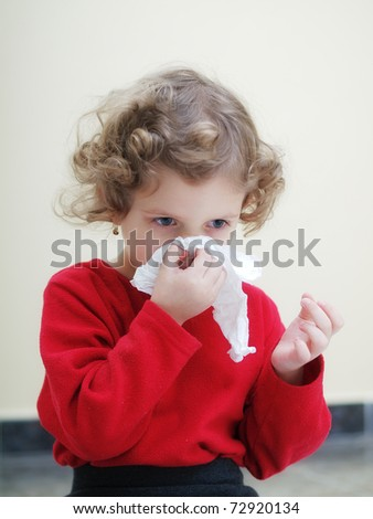 Common cold little girl - stock photo