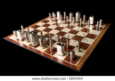 Common household batteries arranged on a chess board in this conceptual image which speaks to strategic energy policies. - stock photo