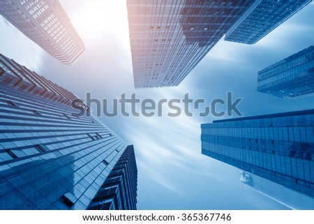 Common modern business skyscrapers, high-rise buildings, architecture raising to the sky, sun. Concepts of financial, economics, future etc. - stock photo