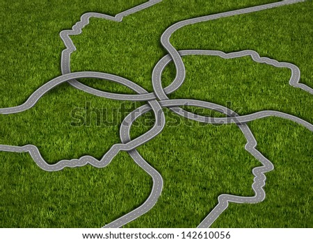 Common strategy business concept with a group of roads and highways in the shape of a human head coming together and merging into a connected network of success on a grass background. - stock photo