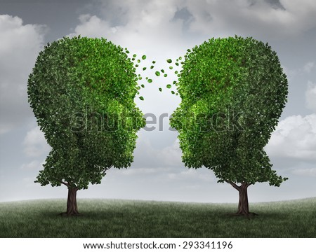 Communication and growth concept as a growing partnership and teamwork exchange in business with two trees in the shape of human heads on a sky with leaves exchanging from one face to the other. - stock photo