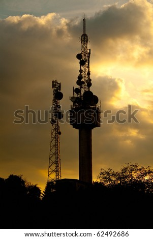 Communication antenna in a dramatic sky - stock photo