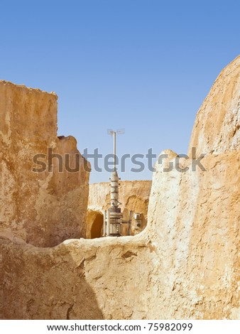 Communication antenna  in Sahara desert village - stock photo