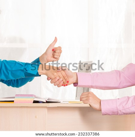 Communication between the client and the employee or office support services. handshake. Manager in the workplace to conduct business meetings with the client. HR manager conducts the interview. - stock photo