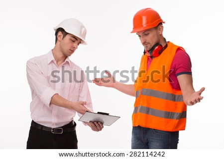 Communication between top manager and his builder about modern trade centre construction. Contractor and worker in helmets discuss working plan on white background. - stock photo