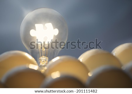 communication business concepts. Idea symbol, light bulb and jigsaw puzzle. - stock photo