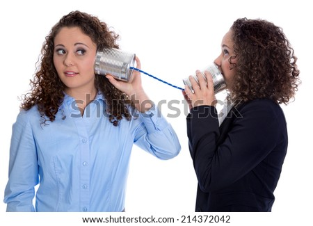 Communication concept: two isolated business woman talking with tin can.