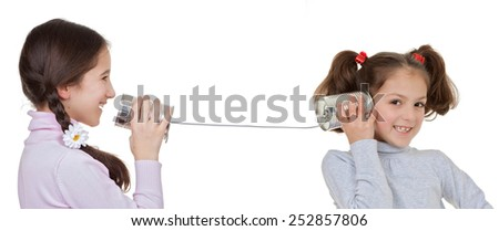communication concepts children playing with tin can and string telephone - stock photo