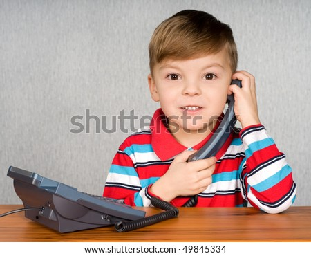 Communication - Portrait of little child talking to an telephone
