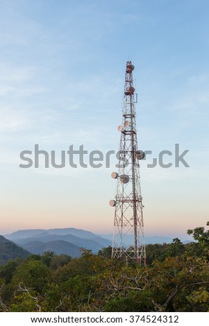 Communication tower antenna on mountain at twilight