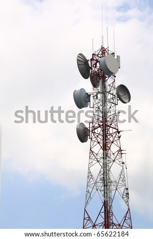 Communication tower over a cloudy sky. - stock photo