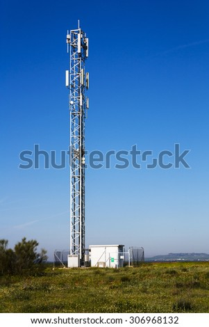 Communications antenna tower for mobile telephony - stock photo
