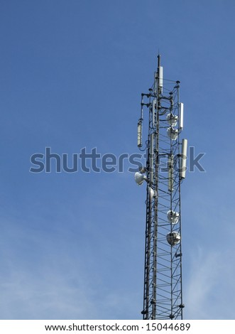 Communications mast set against a clear blue summer sky