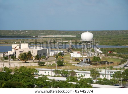 Communications station with satellite antennas and other equipment - stock photo