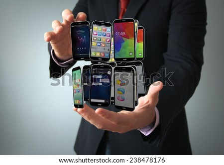 communications technology connection concept: smartphones collection on the hand of a businessman - stock photo
