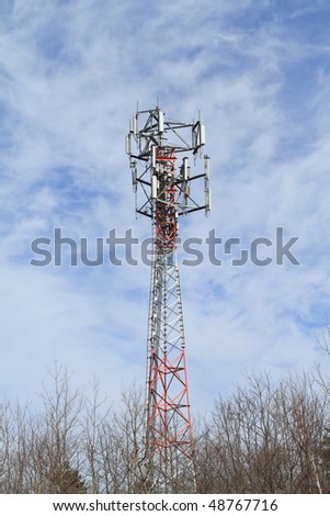 Communications tower against a blue sky - stock photo