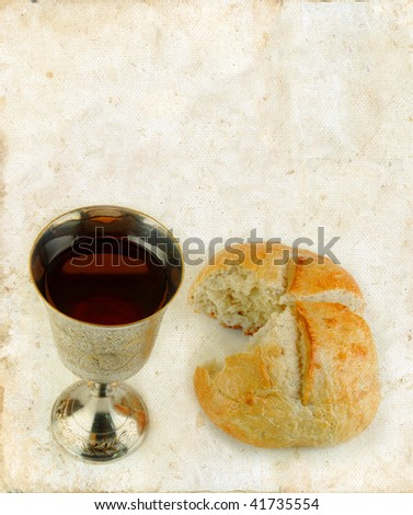 Communion bread and wine on a grunge background. - stock photo
