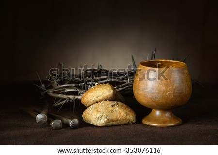 Communion elements with crown of thorns and nails on vintage table - stock photo