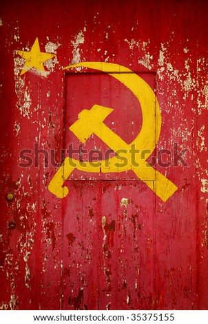 Communist Party symbol in a old wooden door with red paint peeling - stock photo