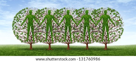 Community and friendship concept with a group of trees in the shape of people holding hands together in harmony as a growing partnership in a strong cooperation on a blue sky. - stock photo