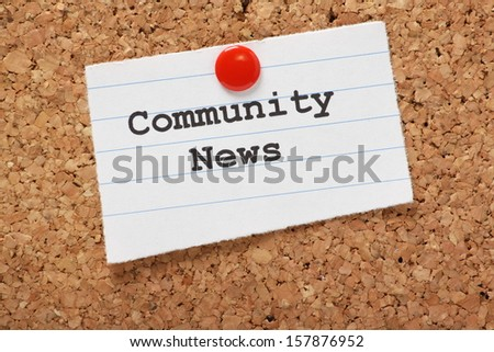 Community News typed onto a scrap of lined paper and pinned to a cork notice board.