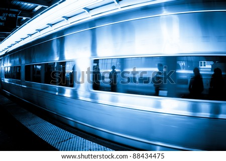 Commuters caught in the reflection of window as a metropolitan rail train goes by - stock photo