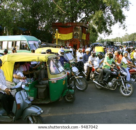 commuters waiting at traffic signal, delhi, india - stock photo