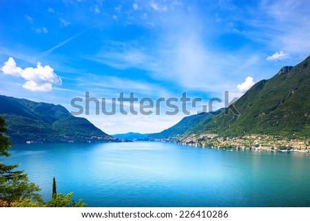 Como Lake landscape. Cernobbio village, trees, water and mountains. Italy, Europe. - stock photo