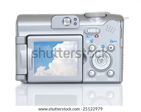 compact digital camera on white background, from back