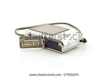 Compact digital camera with battery and cf card shown, white background - stock photo
