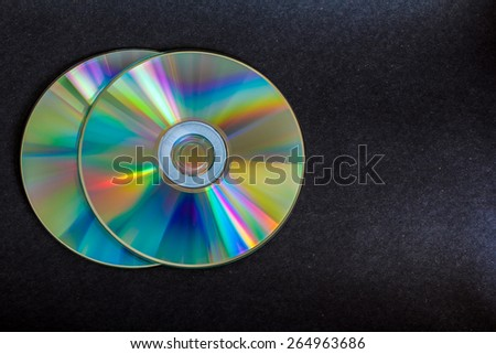 compact discs and digital versatile disc on a black background - stock photo