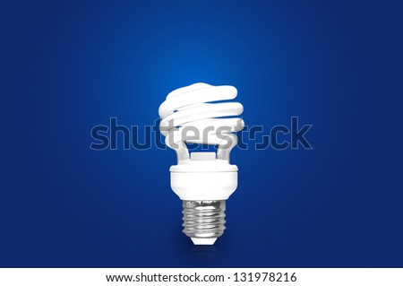 Compact Fluorescent Bulb  on blue background - stock photo