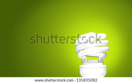 Compact Fluorescent Bulb on green background (CFL) - stock photo