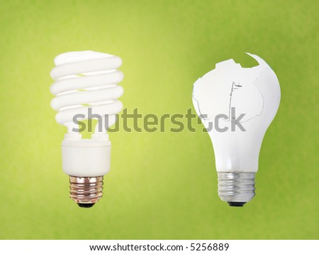 compact fluorescent energy saving environment friendly vs old fashioned broken bulb on green background - stock photo