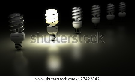 Compact fluorescent lamps in a row. One is lamp is enlightening. Idea Concept - stock photo