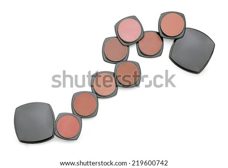 Compact powder set in horizontal composition - stock photo